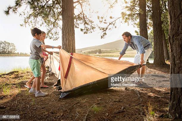 Family is setting up a tent.