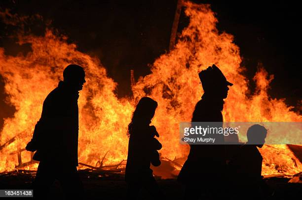 CONTENT] A family is silhouetted by a bonfire on halloween night