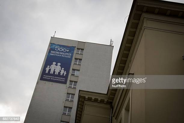 Family is the best investment in the future is a text seen on a banner at city hall of Bydgoszcz, Poland, on 19 May 2016. Recently the new...