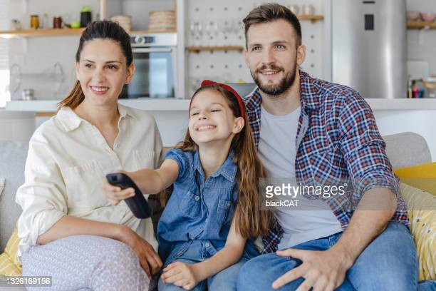 family is watching tv at home - film and television screening bildbanksfoton och bilder