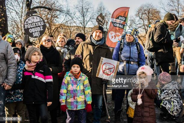 A family join a Greenpeace organised march to call for the political and economic reforms needed to combat climate change while the 24th summit of...