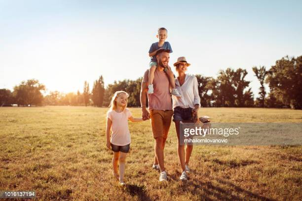 family joy - natural parkland stock pictures, royalty-free photos & images