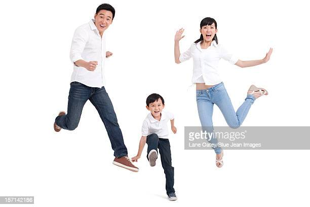 Family jumping in mid-air