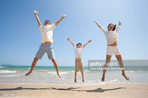 Family Jumping up with Joy