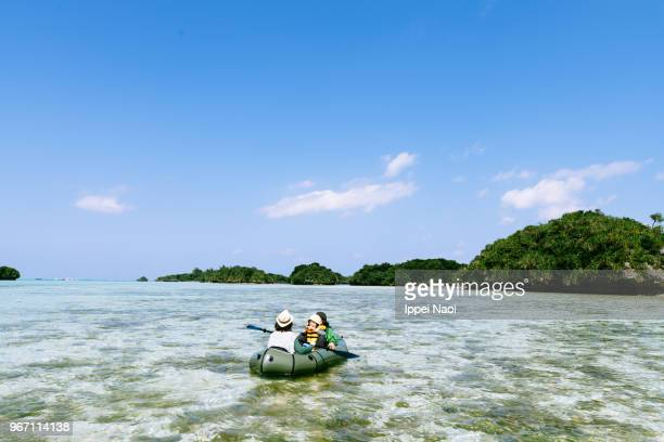 Family kayaking in tropical lagoon with clear water, Ishigaki Island, Okinawa, Japan
