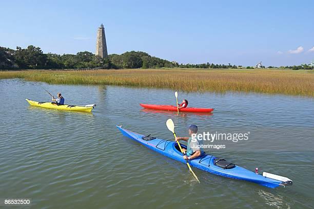 family kayaking - moeras stockfoto's en -beelden
