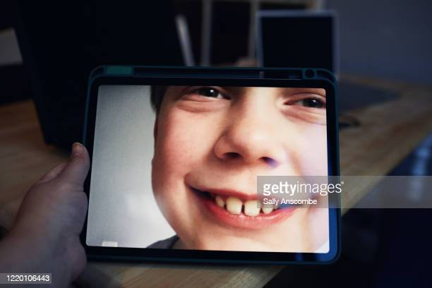 family keeping in touch on a video call - digital tablet stock pictures, royalty-free photos & images