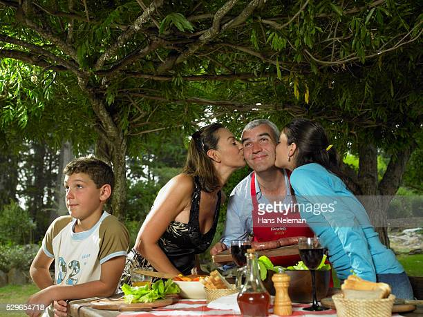 Family Kissing the Cook