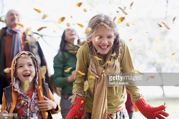 family laughing outdoors - autumn falls stock pictures, royalty-free photos & images