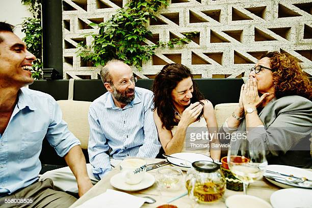 Family laughing together during dinner party