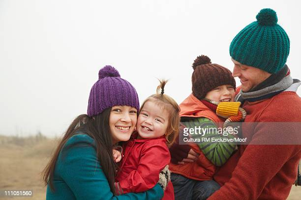 Family laughing together outside