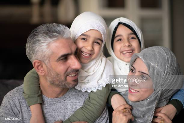 family laughing together - islam stock pictures, royalty-free photos & images
