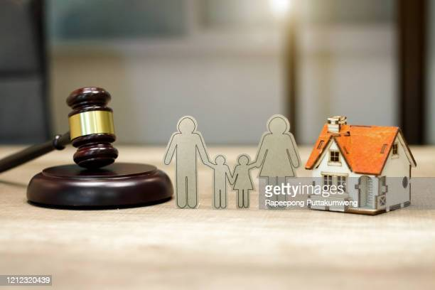 family law concept. house model family paper and judge gavel on the table - divorce stock pictures, royalty-free photos & images