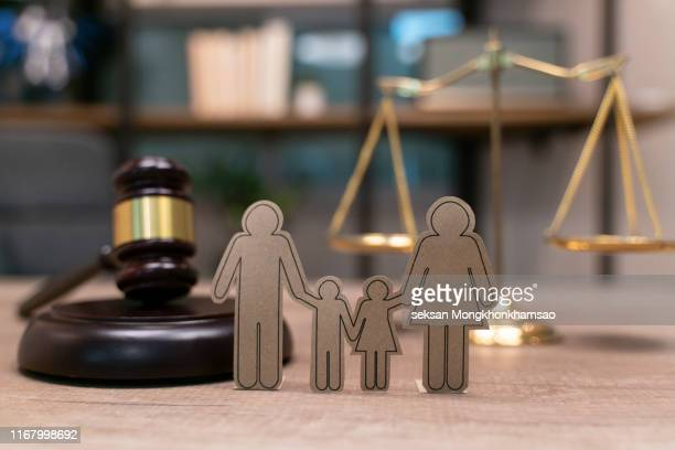 family law, family right concept. child-custody concept. family with children cutout near court gavel - crime or recreational drug or prison or legal trial stock-fotos und bilder