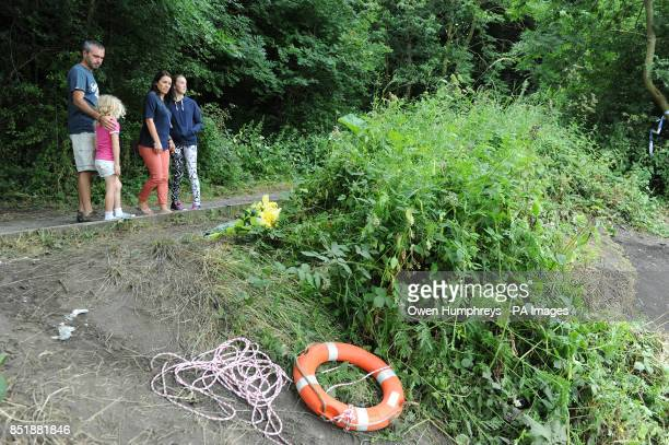 A family lays flowers by the river where Tonibeth Purvis from Barmston Washington Tyne and Wear and Chloe Fowler from Shiney Row near Sunderland died...