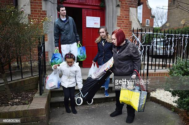 A family leave after collecting food and clothing from a foodbank charity in west London on December 23 2014 Food bank use in Britain is growing...