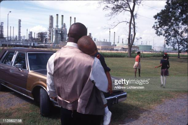 A family leaves Sunday church services surrounded by chemical plants in October of 1998 in Lions Louisiana The poor often black towns along the...