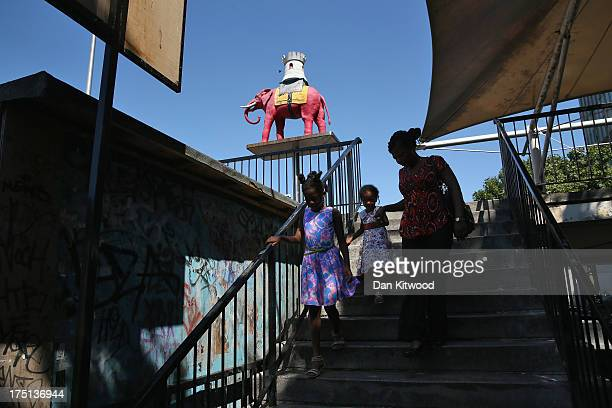A family leaves the shopping centre at Elephant and Castle on August 1 2013 in London England The Mayor of London Boris Johnson was visiting a...