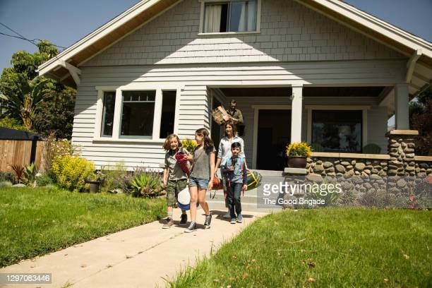 family leaving home for camping road trip - leaving stock pictures, royalty-free photos & images