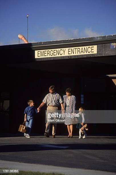 Family leaving hospital, Mt Shasta, CA