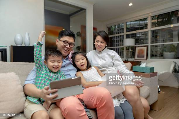 family leisure time at home. - filipino family eating stock pictures, royalty-free photos & images