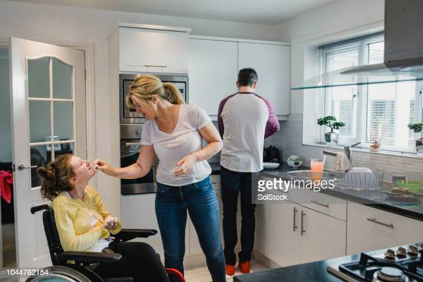family life with disabled daughter - als stock photos and pictures