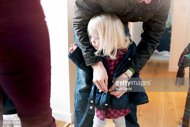 family lifestyle - coat stock pictures, royalty-free photos & images