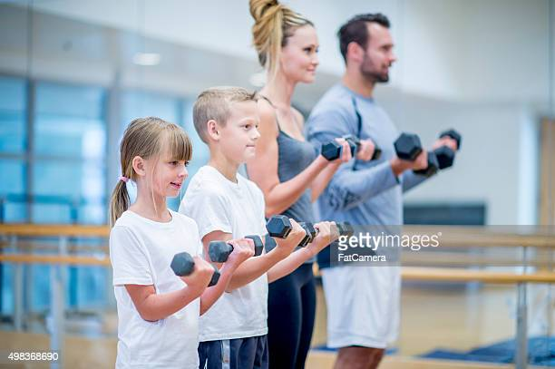 Family Lifting Weights Together