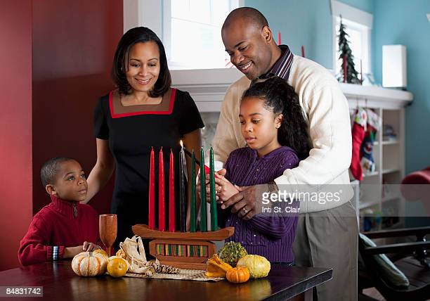 Family lighting Kinara for Kwanzaa together