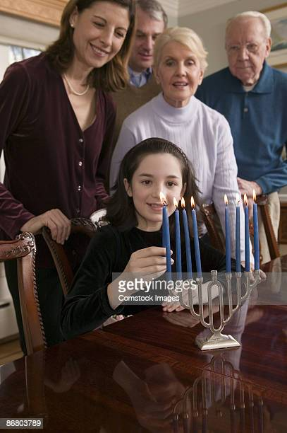 family lighting menorah - judaism stock pictures, royalty-free photos & images