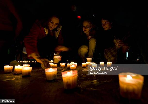 A family lights candles during a demonstration against Climate Change in Mexico City on December 12 2009 In the framework of worldwide protests...