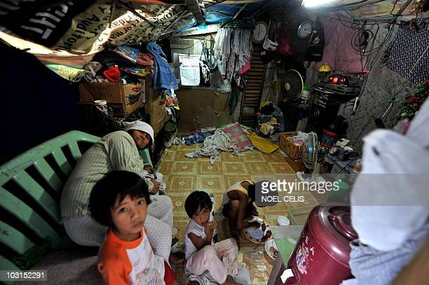 A family lives on a shanty near the national heroes cemetery in Manila on July 29 2010 Two women have been sentenced to six years each in jail for...