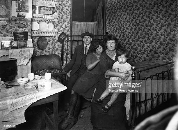 A family living in deprived conditions in a slum tenement house in Lisburn Street Bethnal Green East London
