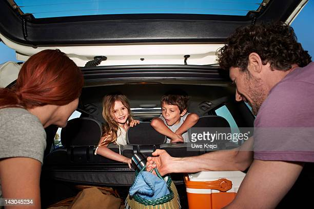 family loading car for trip - white boot stock pictures, royalty-free photos & images