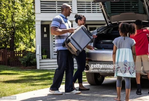 family loading car for vacation - black boot stock pictures, royalty-free photos & images