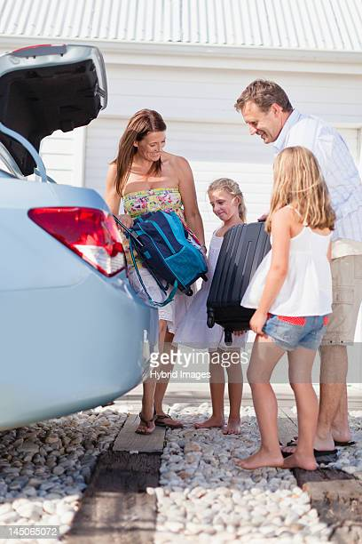 Family loading up car trunk