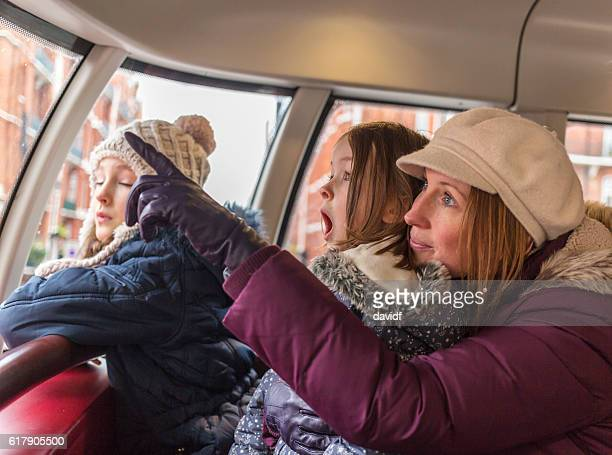 Family Look in Wonder on London Bus