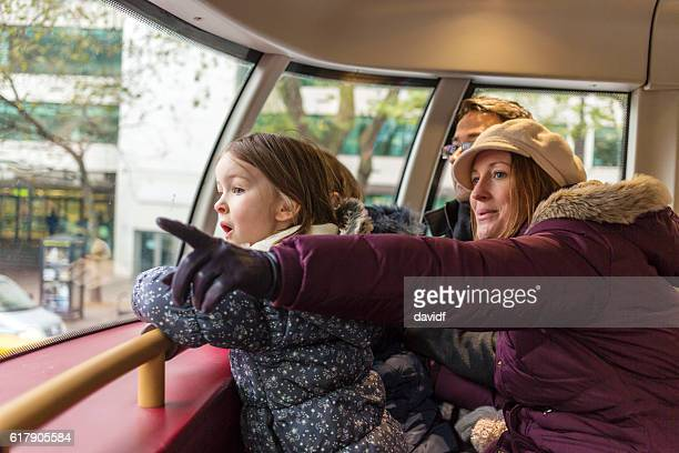 Family Look in Wonder on London Bus