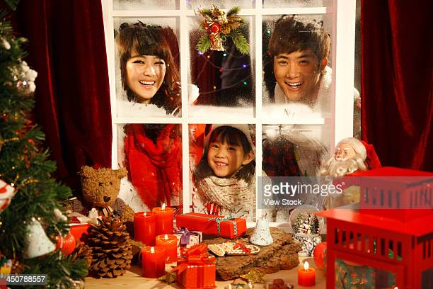 Family looking at Christmas gift through window