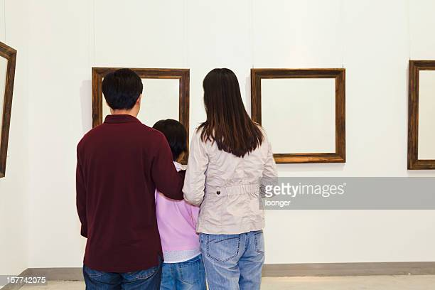 Family looking at painting in an art gallery