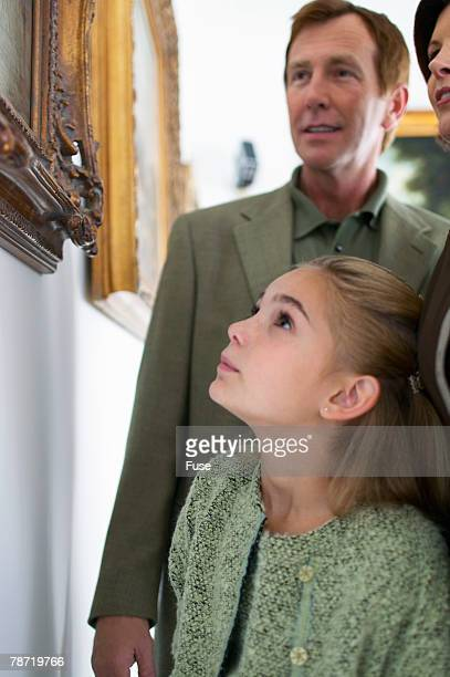 Family Looking at Paintings
