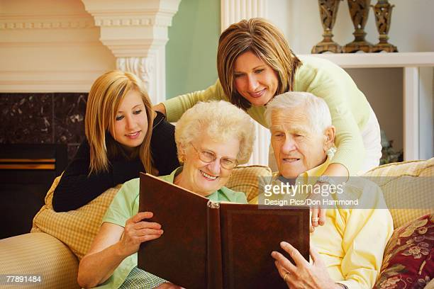Family looking at photo album