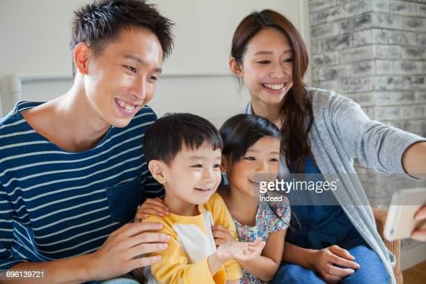 Family looking at smart phone