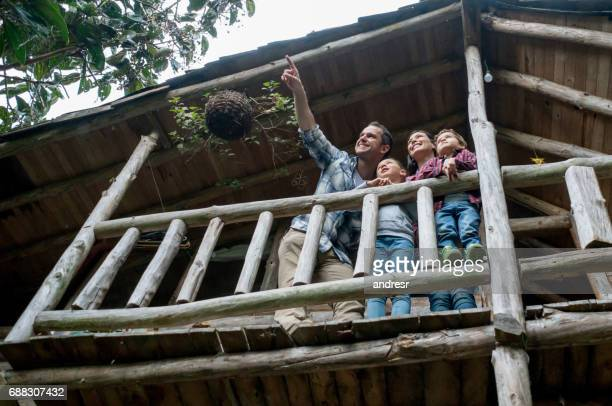 family looking at the view from their cottage - cottage stock pictures, royalty-free photos & images