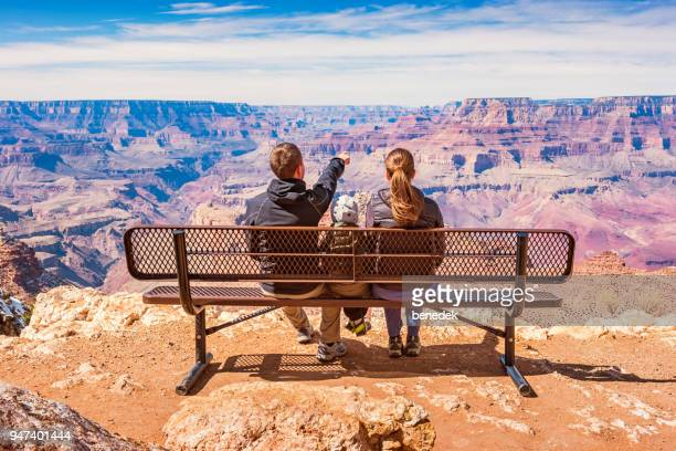 Family looking at view Grand Canyon National Park USA