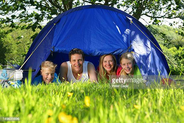 family looking out from tent