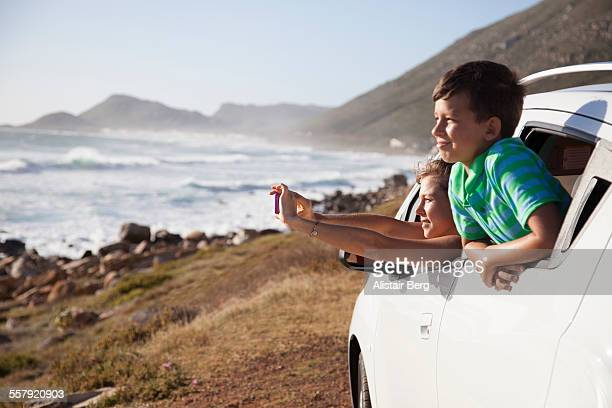 Family looking out of car on holiday together