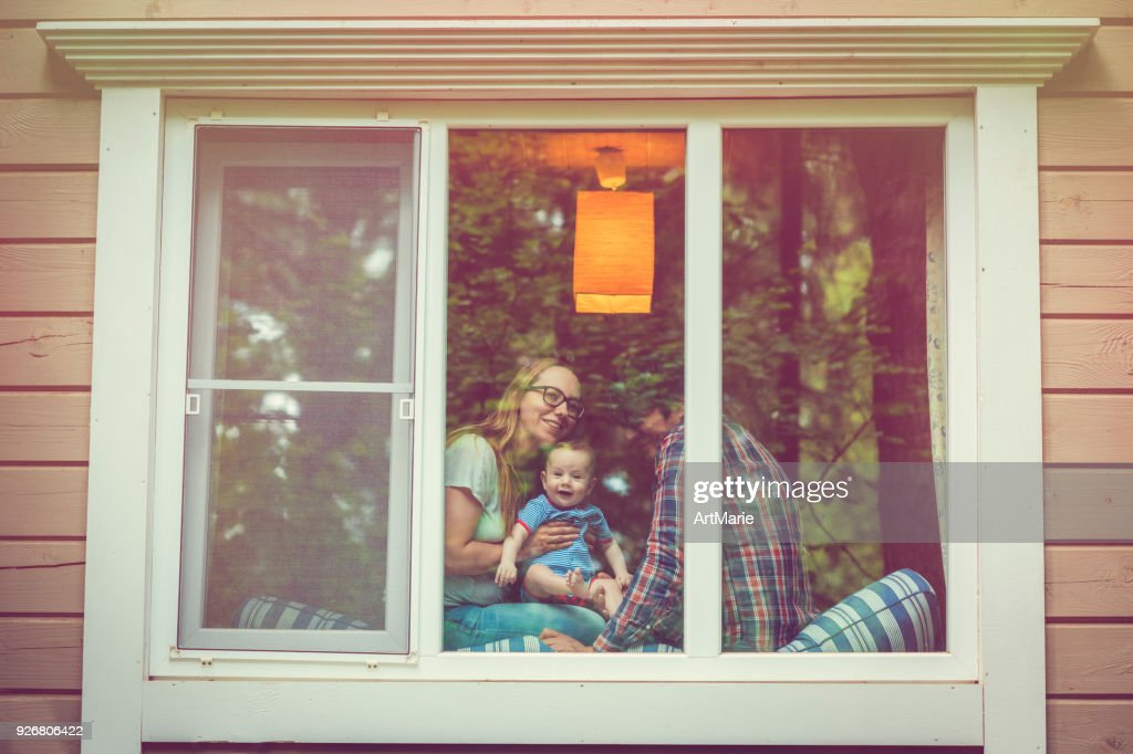 Family looking out of the window : Stock Photo