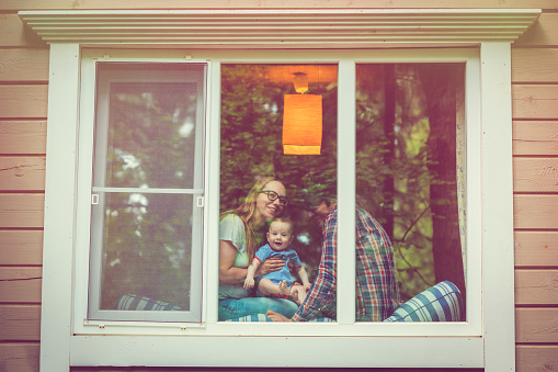 Family looking out of the window - gettyimageskorea