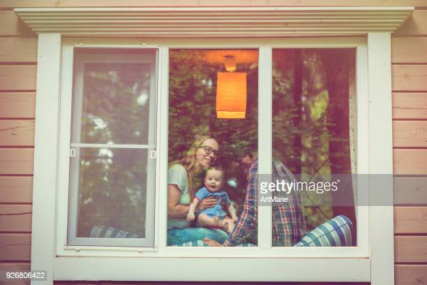 family looking out of the window - looking through window stock pictures, royalty-free photos & images